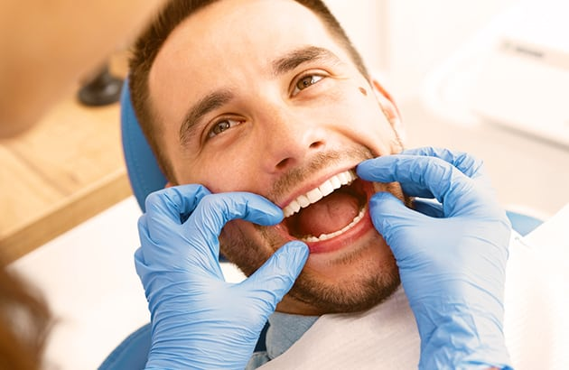 Dental Patient getting Examined
